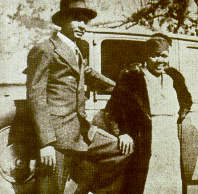 BESSIE SMITH AND RICHARD MORGAN IN FRONT OF THE OLD PACKARD